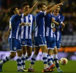 Wigan Athletic's Powell celebrates scoring with teamates against FC Rubin Kazan during Europa League soccer match in Wigan