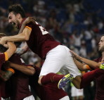 AS Roma's Gervinho celebrates with teammates after scoring a goal against Fiorentina during their Italian Serie A soccer match at the Olympic stadium in Rome