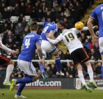 Daryl Murphy of Ipswich Town clashes with Ryan Tunnicliffe of Fulham as he scores the opening goal, 0-1 -------------------- Joe Toth / BPI Sky Bet Championship 2014/15 Fulham v Ipswich Town Craven Cottage, Stevenage Rd, London, United Kingdom 14 February 2015 ©2015 Joe Toth / BPI all rights reserved