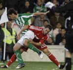 Real Madrid's Gonzalo Higuain from Argentina, right, and Betis' Chechu Dorado, left, fight for the ball during their La Liga soccer match at the Benito Villamarin stadium on Saturday, March 10, 2012. (AP Photo/Angel Fernandez)